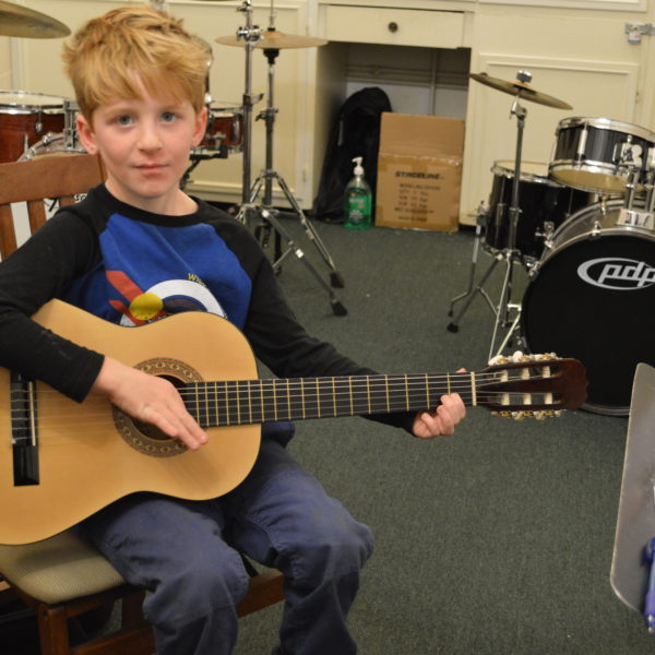 Student with Sunlite Guitar